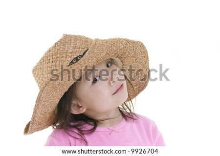 A young asian american girl being silly with a cowboy hat