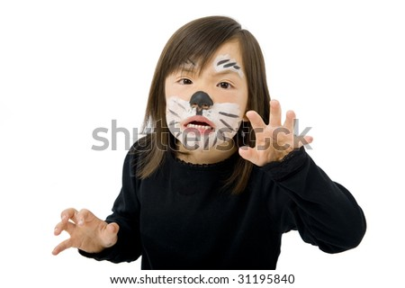 A young asian girl dressed up as a tiger