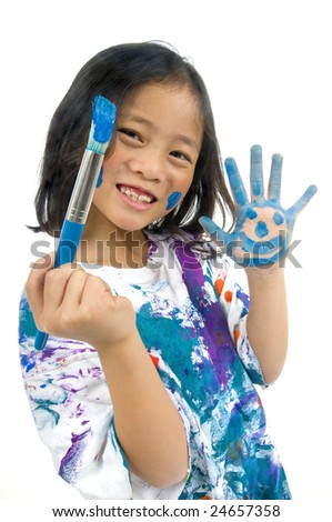 A young asian girl having fun painting her hands