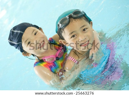 A young asian girl in the swimming pool