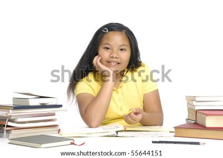 A young asian school girl reading a book. - stock photo