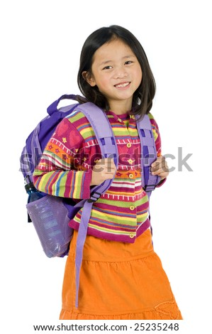 a young asian school girl ready for school