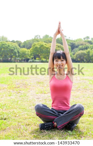 a young asian woman exercising in the park - stock photo