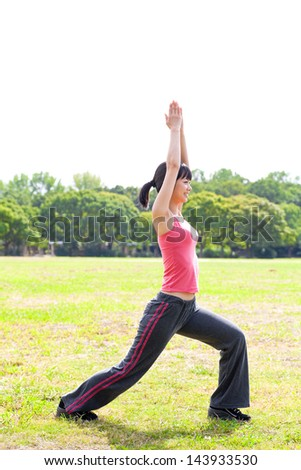 a young asian woman exercising in the park