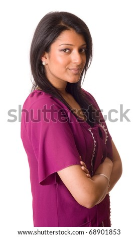 a young asian woman in traditional clothing with her arms crossed isolated on a white background. - stock photo