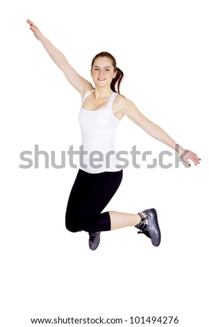 A young, athletic and beautiful woman is jumping.