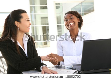 A young attractive and diverse women business team with computer