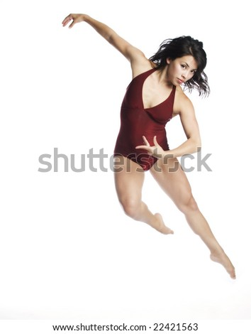 A young attractive Asian woman in red dancing in the air on white background.