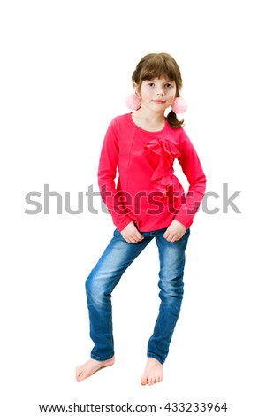 A young attractive girl in red blouse is standing full length - stock photo