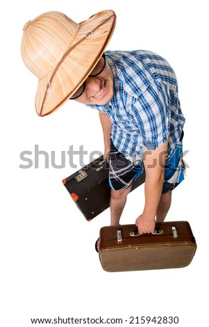 A young attractive man with glasses and two suitcases ready to travel. The stereotype of a foolish novice traveler. Portrait of a traveler in a full-length isolated on white background - stock photo