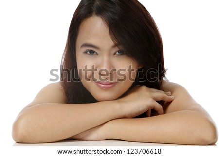 A young attractive woman smiling and relaxing - stock photo