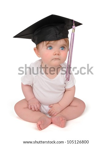 A young baby has on a graduation black cap with a tassel on a white isolated background. Use it for a school or education concept.