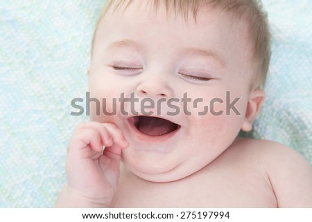 A young baby lay on  - stock photo