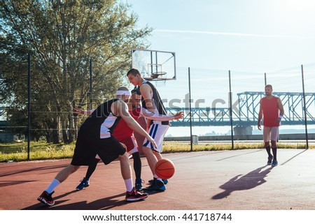 A young basketball player dribbling a ball. - stock photo