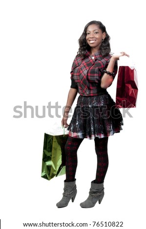A young beautiful black African American teenage woman on a shopping spree - stock photo
