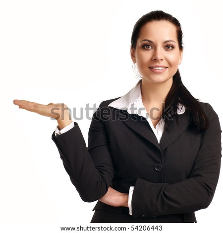 A young beautiful business woman pointing at copyspace - stock photo