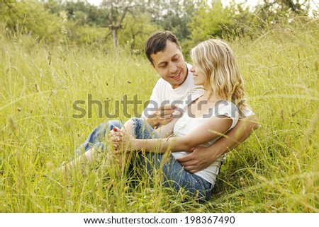 a Young beautiful couple in love outdoors