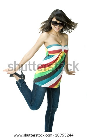 A young beautiful girl in a bright top with sunglasses spinning - stock photo