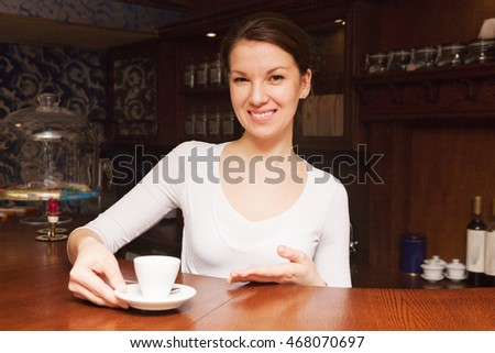 a young beautiful girl made coffee and offers