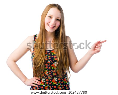 A young beautiful girl smiling and pointing right
