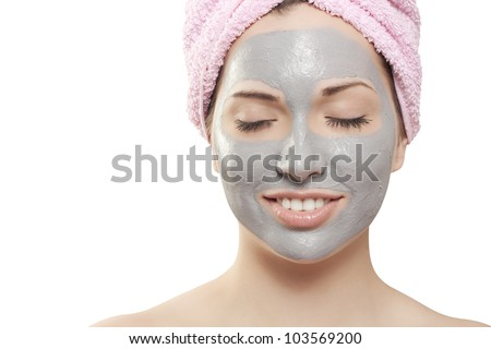 A young beautiful girl with mud mask on face