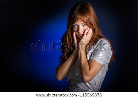 A young beautiful woman is gazing - stock photo