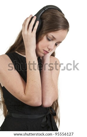 A young Beautiful Woman teenager girl listening to headphones