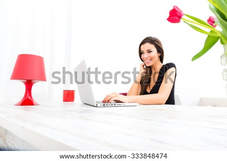 A young beautiful woman using a Laptop computer at home. - stock photo