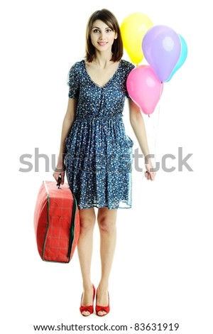 A young beautiful woman with balloons and a bag - stock photo