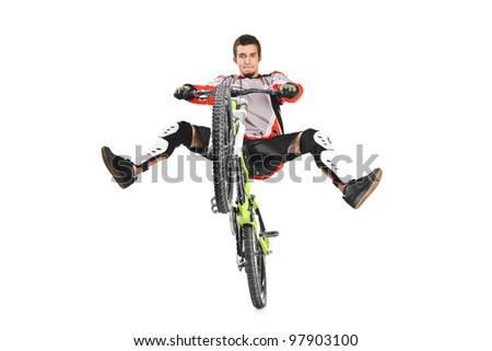 A young biker with his bike jumping isolated on white background - stock photo