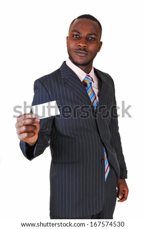 A young black business man standing in a suit and tie, holding up a business card for white background.  - stock photo