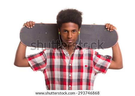 A young black skater posing in studio - stock photo