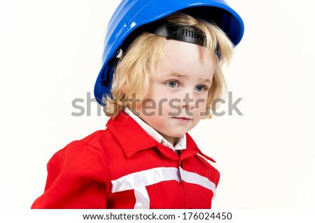 A young blond haired child wearing a red uniform and a blue hard hat. - stock photo