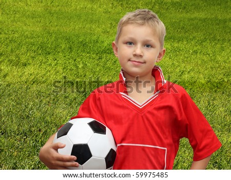 A young boy and soccer ball.
