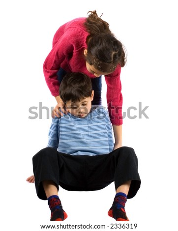 A young boy being helped by his sister after tripping over, isolated on white. - stock photo