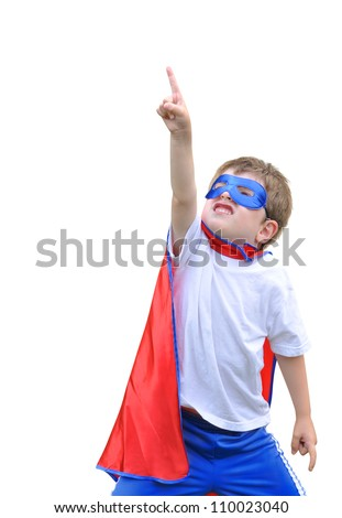 A young boy is dressed up as a superhero and pointing up with a mask and cape. There is a white isolated background. Use it for a strength or halloween concept. - stock photo