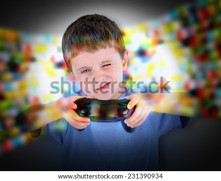 A young boy is playing a video game with a controller. He is concentrating hard for a entertainment or leisure concept. - stock photo