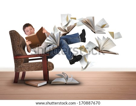 A young boy is reading a book floating in in the air on a white isolated background. There are pieces of paper flying up around him for an education concept.  - stock photo