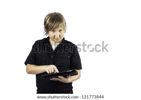 A young boy isolated on white using technology - stock photo