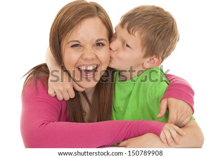A young boy kisses a girl on the cheek.