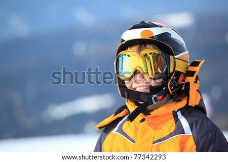 A young boy skier in his snow gear. - stock photo