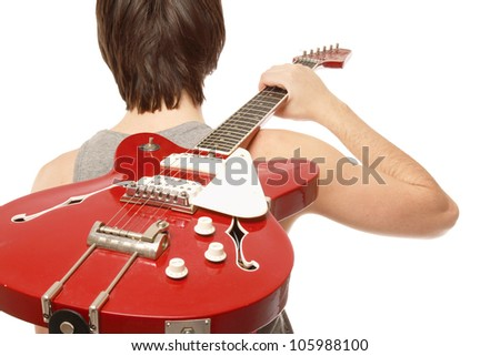A young boy standing with his back with bass guitar on white background - stock photo