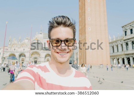 A Young boy takes a self-ie of himself, on Holiday - people,lifestyle,outdoor and Holiday concept - stock photo