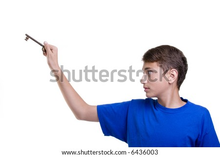 A young boy unlocking his future Isolated on white.