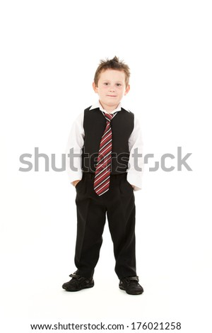 A young boy with suit and a striped tie.