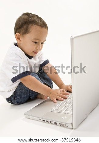 A young boy working on a laptop