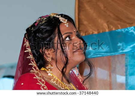 A young bride with joy in her eyes - stock photo