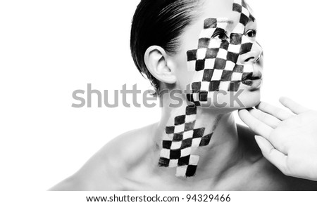 a young brunette wearing a creative chess make up - stock photo