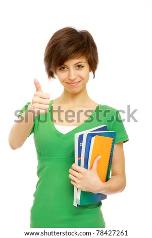 A young brunette woman (student) with books looking up - stock photo