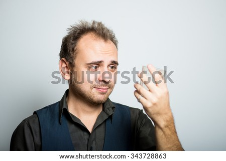 a young business man drinking a cup of requests, manager, office style studio shot isolated on the gray background
